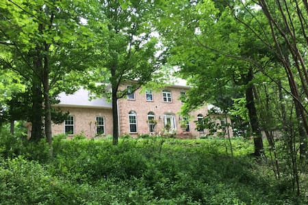 Luxurious home on 110  acres near CenterHill Lake