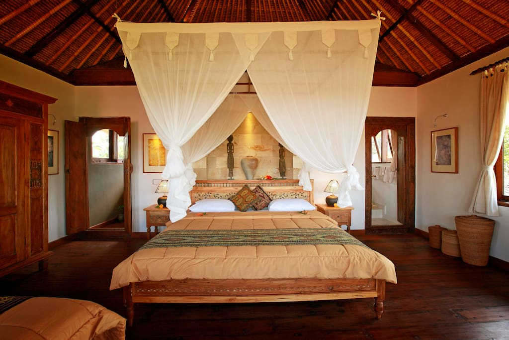 The upstairs suite has the warmth of wooden floors - all wood is recycled teak