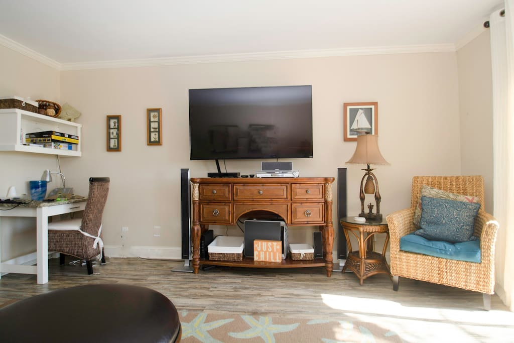 The living room has a large screen TV and a desk for your laptop.