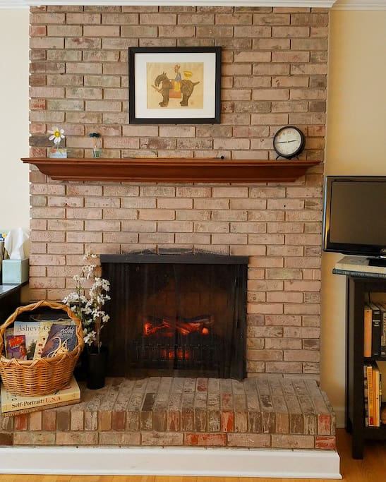 Faux fireplace provides excellent heat in colder weather.