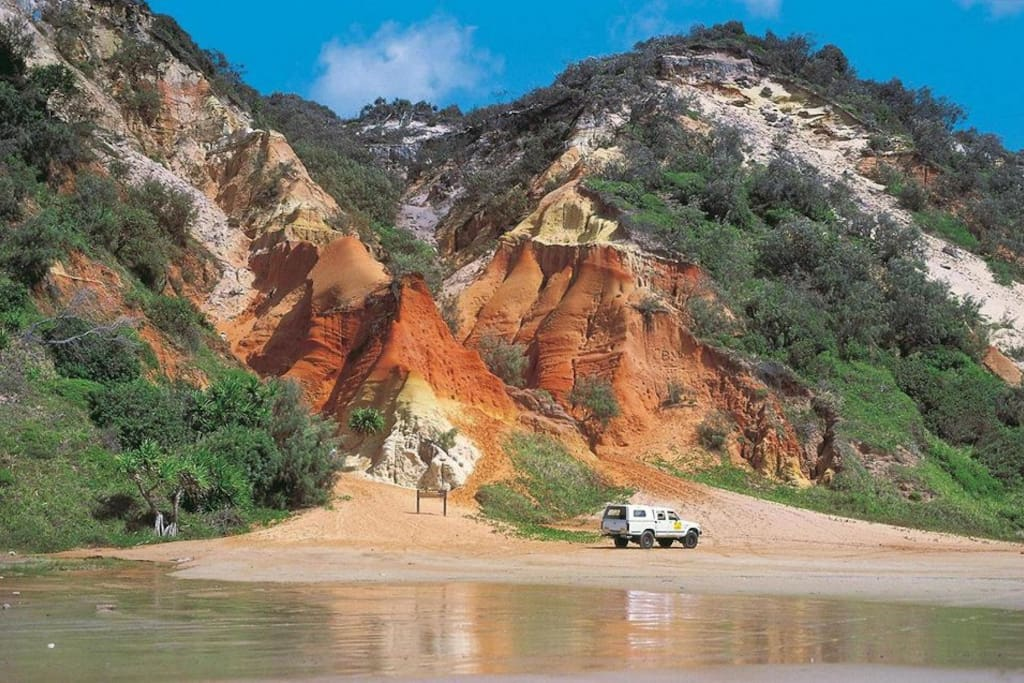4 wheel driving on our beach to see the coloured sands.