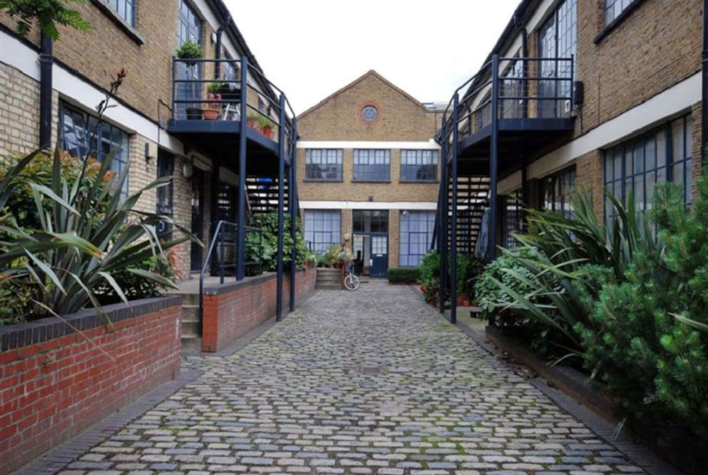 Peaceful cobbled courtyard entrance