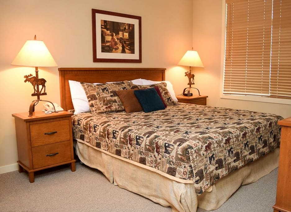The master bedroom features a king sized bed with an attached 4 piece ensuite