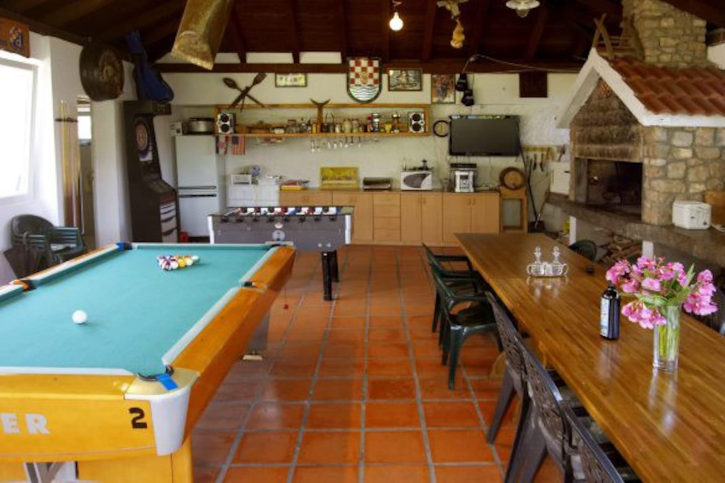 large kitchen, party area, pool table, darts, table football