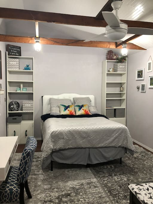 Recently remodeled from a workshop to a suite, this room features a queen bed and a hummingbird theme.