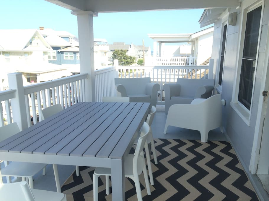 newly furnished large front porch with view of ocean