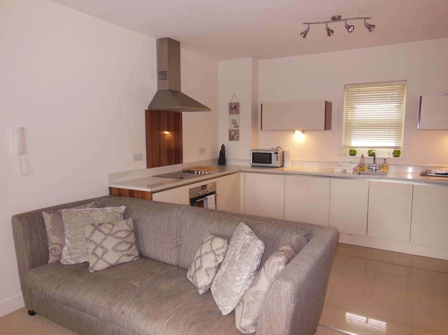 Kitchen/living area with dining table for 4 people.