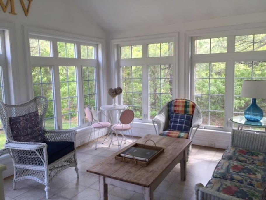 Beautiful sun room overlooking the gardens and patio