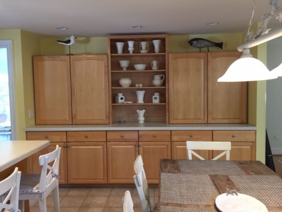Eat in kitchen with plenty of Maple cabinets.  The kitchen has commercial grade appliances and island.  Plenty of room