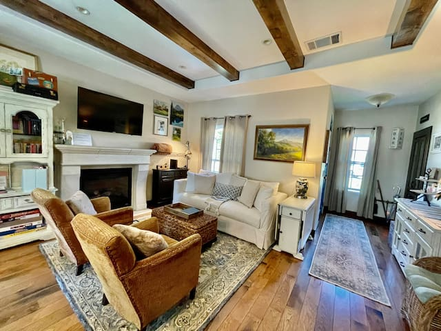 Family room with fireplace and queen sofa sleeper.