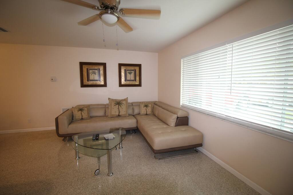 "Spacious living room  with sectional seating to watch 55"" tv"