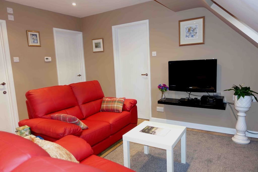 Lounge area with entertainment electronics: TV, DAB radio and DVD player