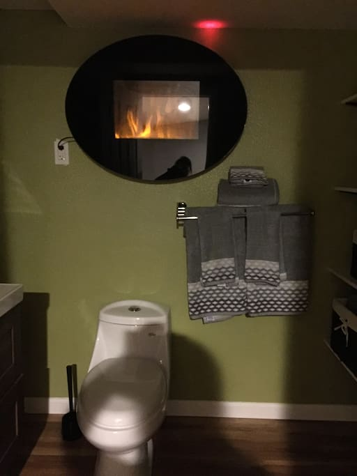 Wall electric fireplace in the bathroom