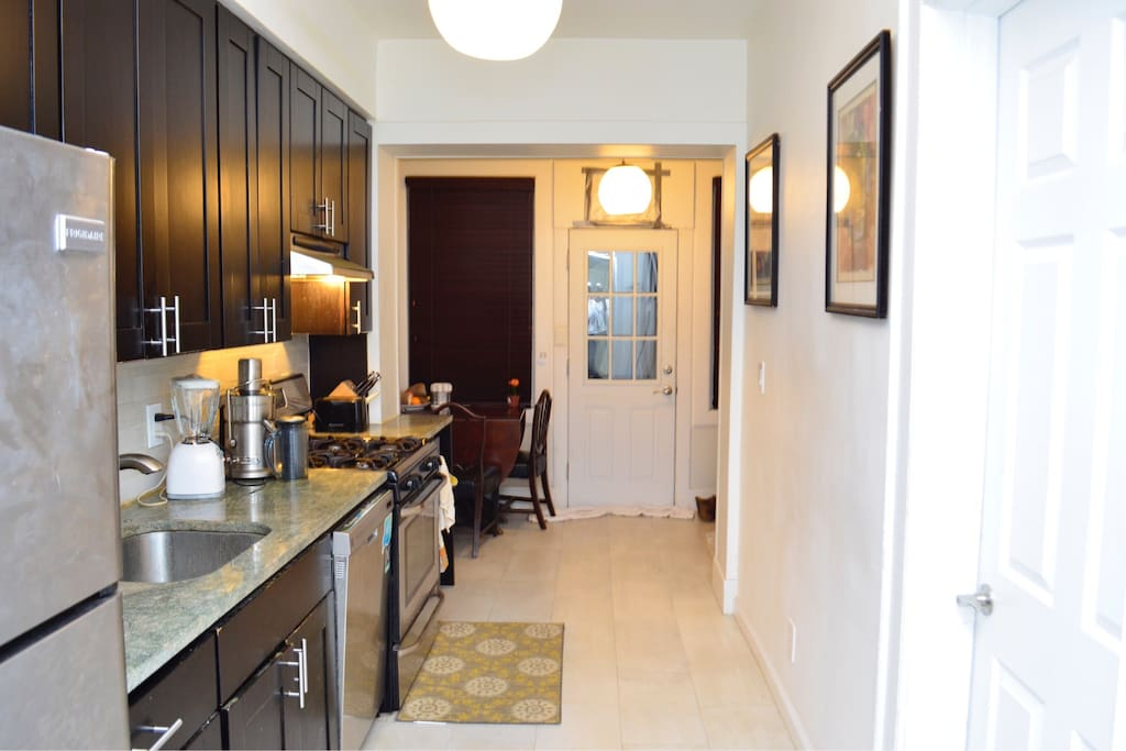 The chic kitchen with granite countertops and SS appliances, stocked for all your cooking/eating needs.