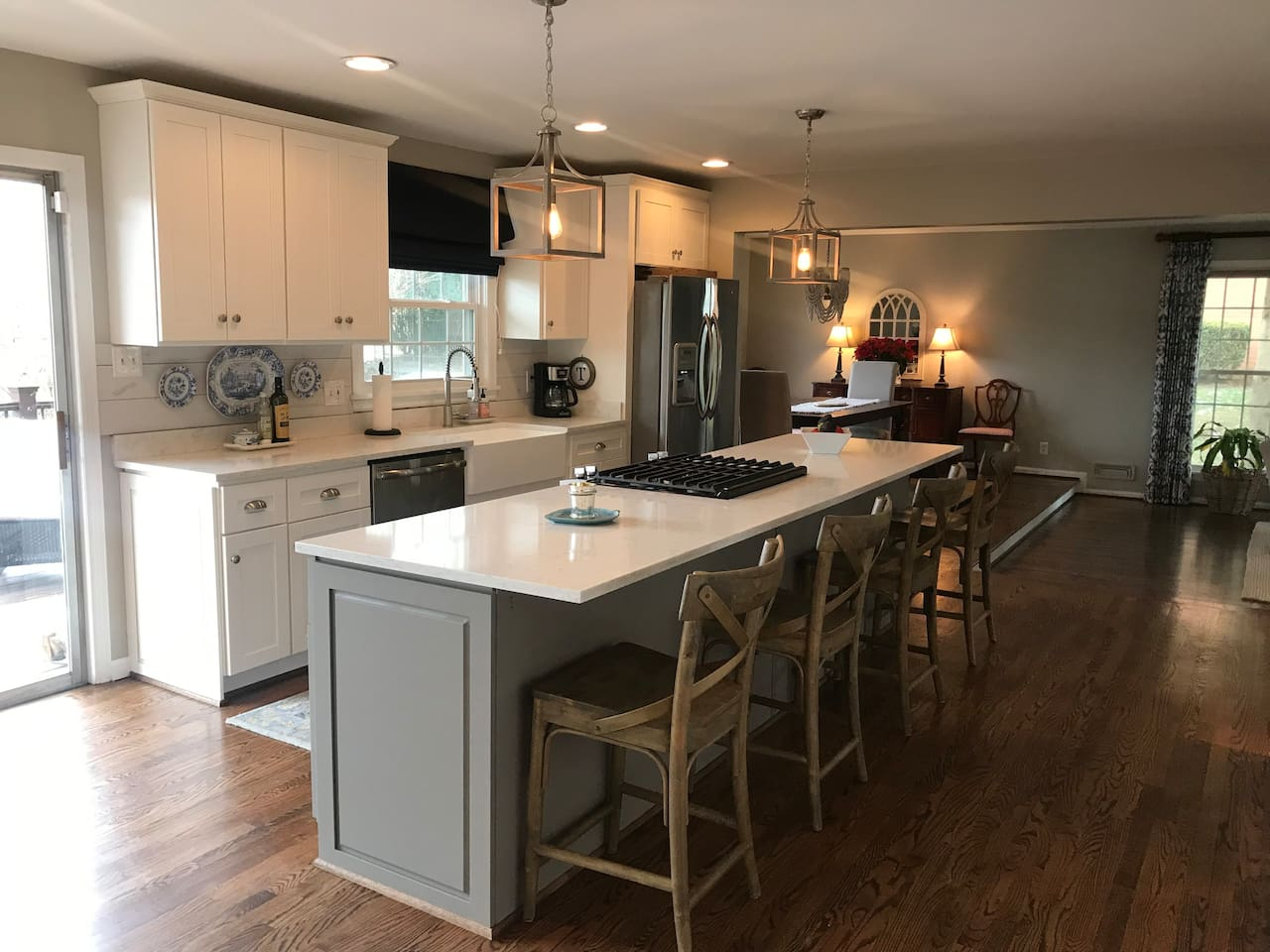 Kitchen with stainless steel appliances and gas stove top. Walks out to a back deck.