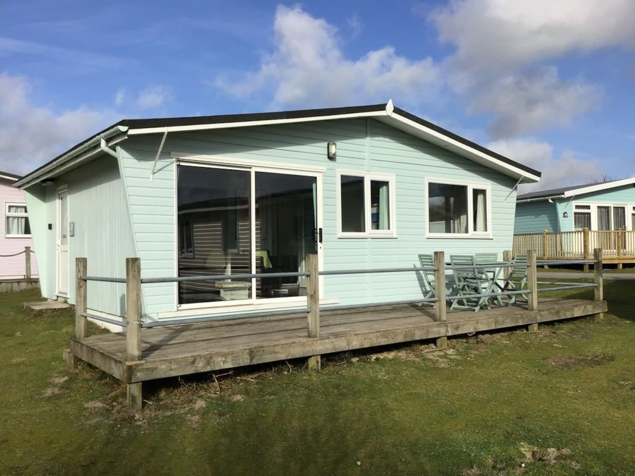 Surfside is a stylish beach chalet by the dunes at Gwithian Sands and sleeps up to 4 adults and 2 children