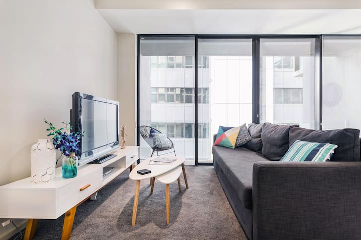 Explore Melbourne from a Stylish Apartment with Pool Access