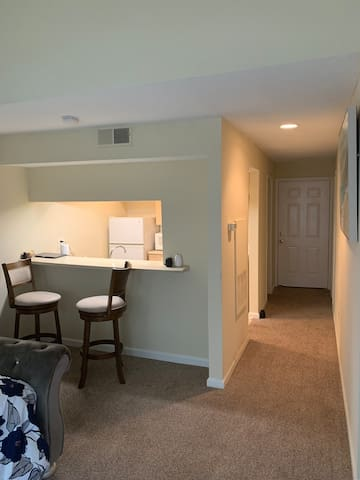 Here is a view of the kitchen entrance door and hallway.