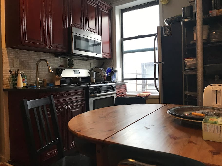 Clean shared kitchen. You are welcome to cook to your hearts delight. Pots/pans/dishes are all communal. Feel free to keep any food/groceries in the fridge.