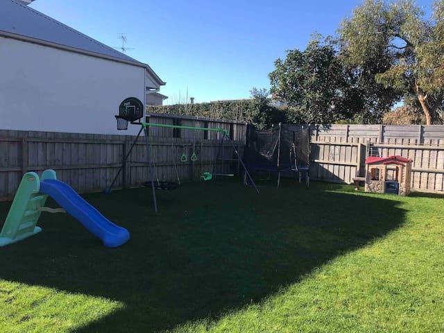 Children's swing set, trampoline, slide, cubby house