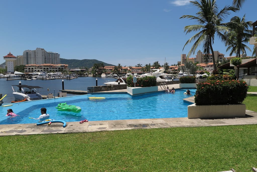 Swimming pool view from the terrace and view of the marina