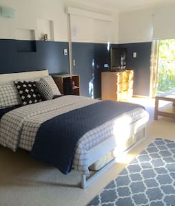 Beachstyle modern large studio room - Currumbin