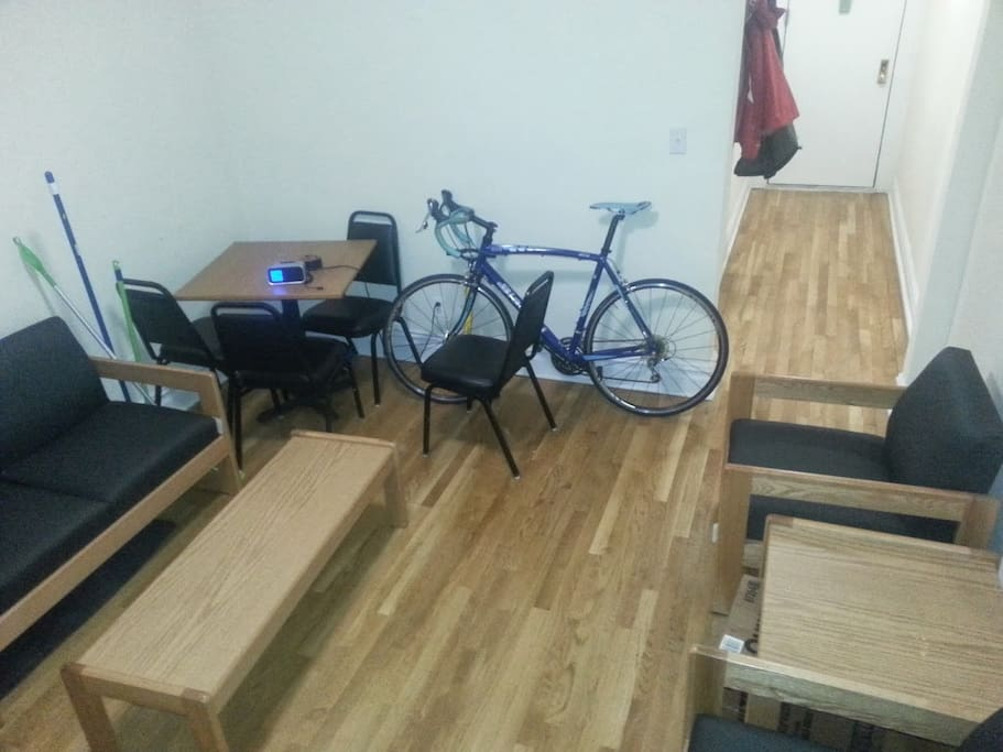 Dorm-style furniture in the living room, but it's a large space.