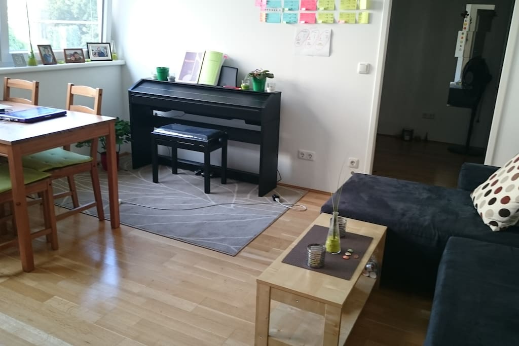 Sofa, table and a piano :)