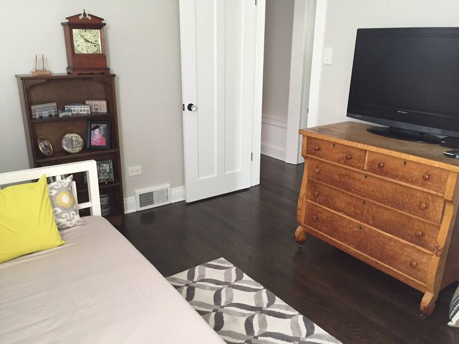 TV in private bedroom with daybed.