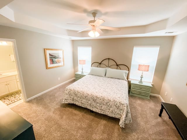 Main bedroom with king bed and adjoining bathroom