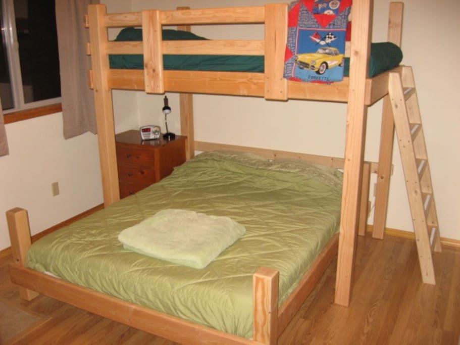 The bedroom includes a double bed (below) and single (above).