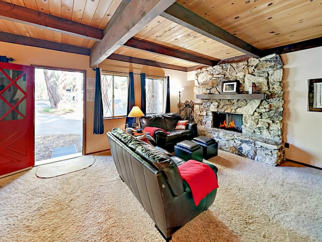 Enjoy the warm ambience of the gas fireplace in the living room.