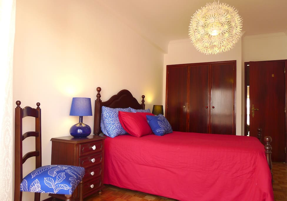 Bedroom 1 with double bed and balcony.