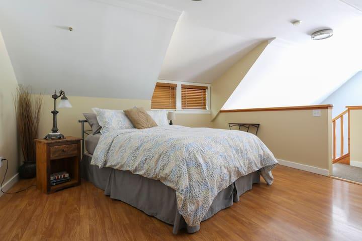 Loft bedroom with oh so comfy queen bed.