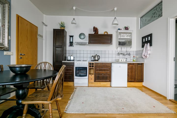 Livingroom with a fully fitted kitchen
