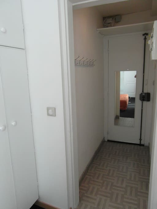 Entrance with hangers and mirror and storage / wardrobe closet