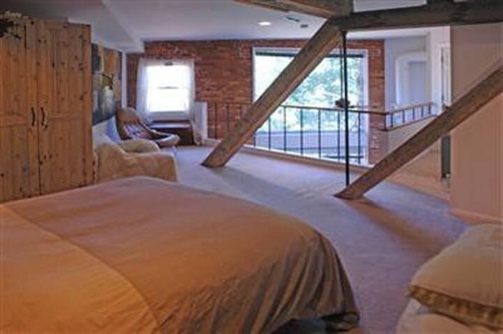 3rd floor open plan bedroom.