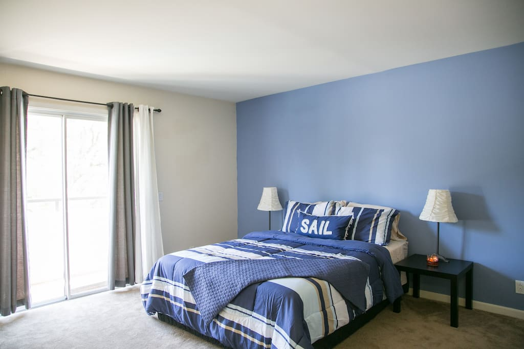 Guest bedroom has a queen size bed and large wrap around balcony.