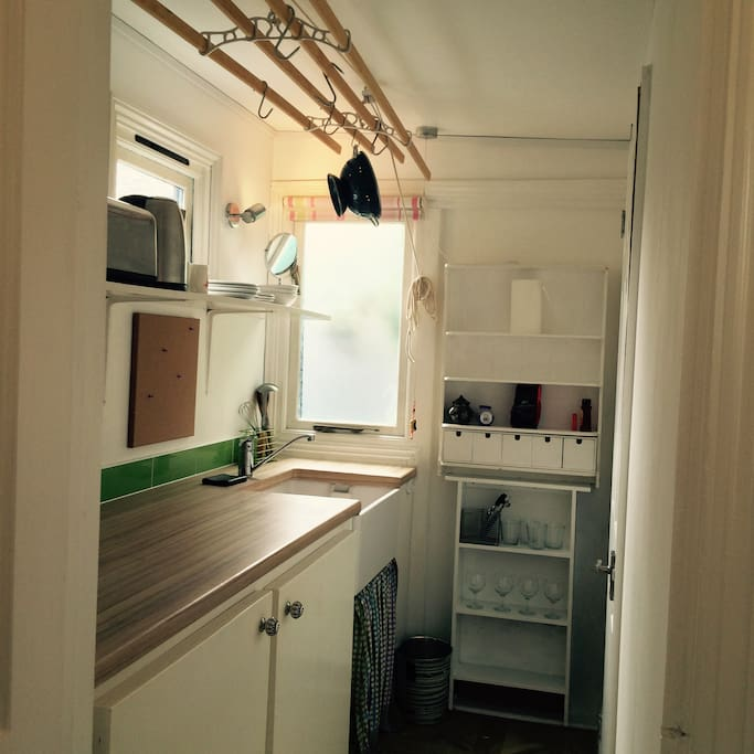 Kitchen with microwave, small hob, plates and cooking equipment (2.23 x 1.43 metres)