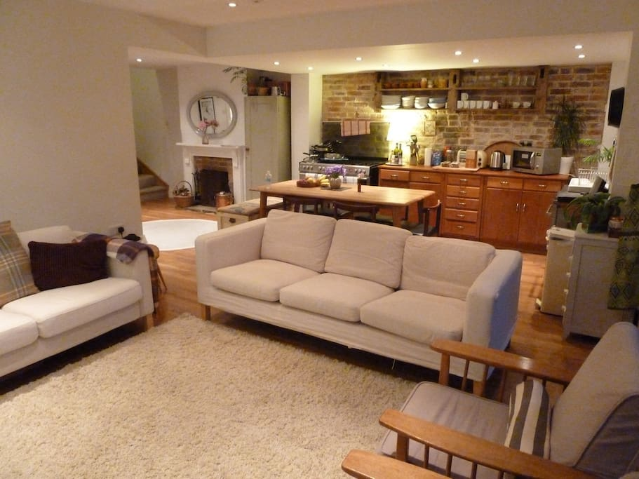 The open plan main room with large kitchen and lounge area