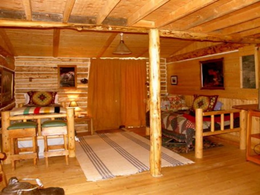 Two log beds with all linens