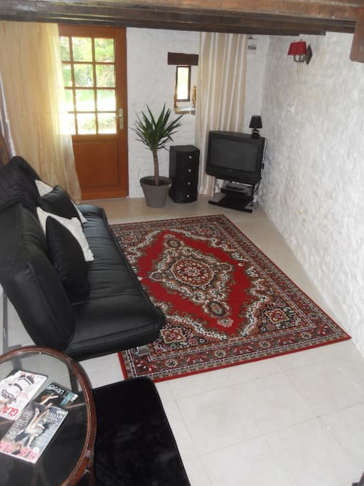 Small seated living area.  Use of DVD/CD player with a selection of DVDs/CDs available as well as books.