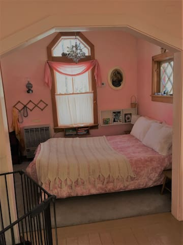 Bedroom has a full-sized futon with spring mattress, also a folding screen for privacy.