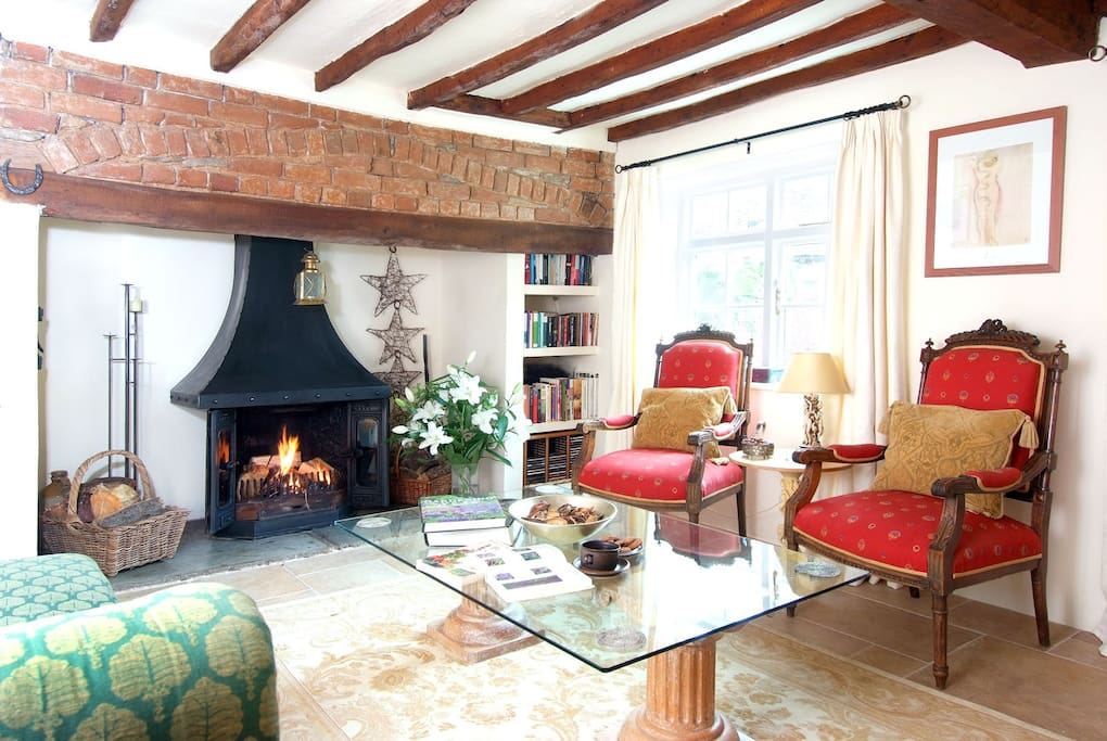 Beams galore in the living room, which is light and airy in the summer and cosy sitting by the inglenook on a chilly day