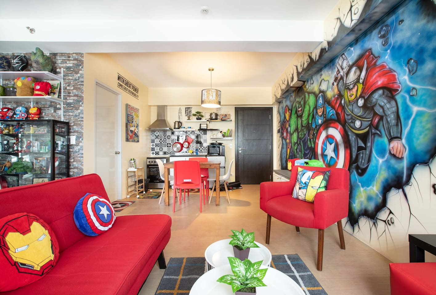 Our Marvel-inspired AirBnB unit in BGC is a bright and sunny studio with a black, white and red theme. The beautiful colors of Marvel items and artwork pop out in this well-designed space.