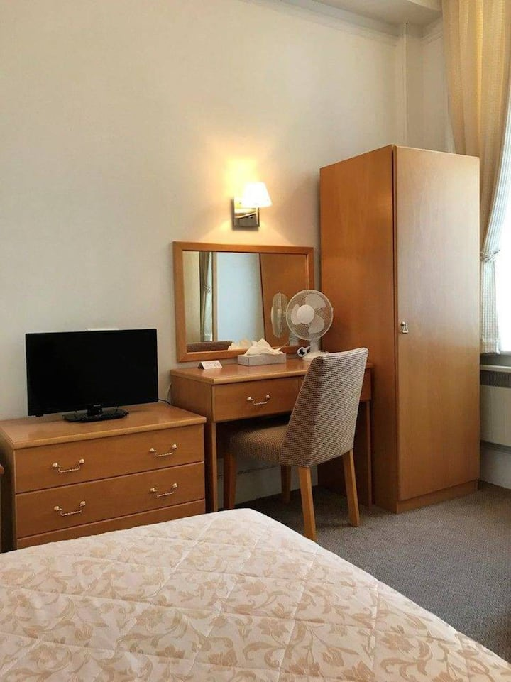 Single Room in the Premier AA Four Star Langham Hotel Eastbourne