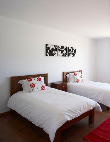 Upstairs twin bedroom with sliding doors to balcony