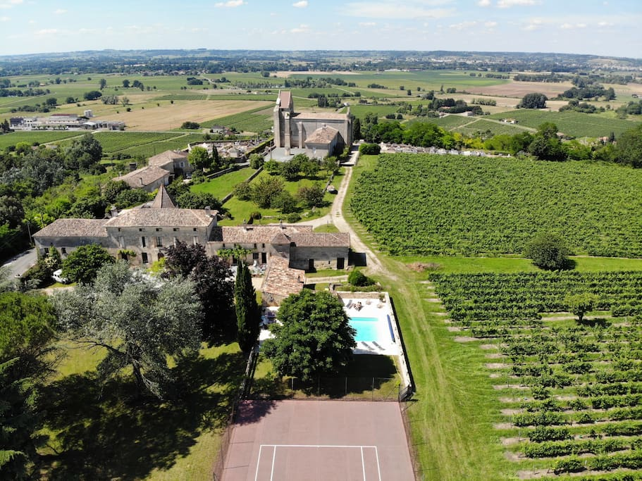Arial view with XII century church in the background.  Heated swimming pool & tennis court in the foreground
