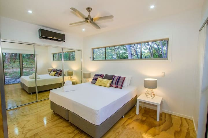 Air Conditioned King-sized master bedroom with adjoining ensuite with shower, WC and standalone bath - DVD player and a flat-screen TV .
