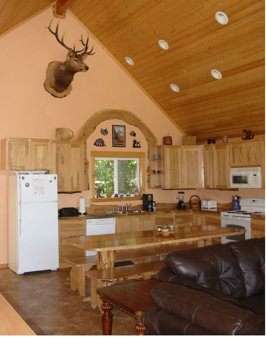 Kitchen w/custom-made, 9 ft., live-edge table with matching benches.